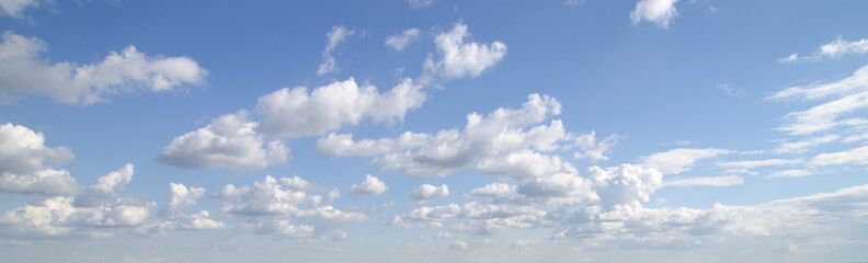 Clouds flying in deep blue sky