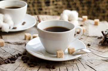 two cups coffee wooden stump