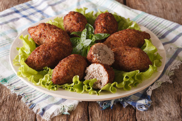 Arabic meat appetizer kibbeh close-up on a plate. horizontal
