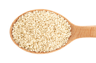 Wooden spoon with sesame seeds isolated on white background.