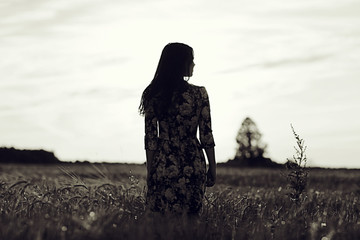 black and white photo of the girl in a field freedom