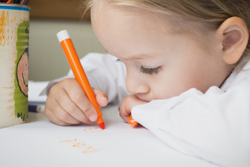 Creativity concept. Little girl drawing