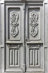 Old vintage wooden white door with floral patterns. Grodno, Belarus.