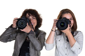 Portrait of a two photographer covering her face with the camera
