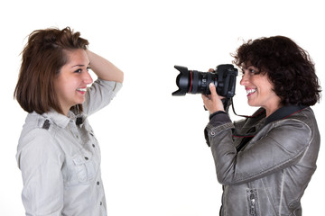 Photographer taking photo of a female model