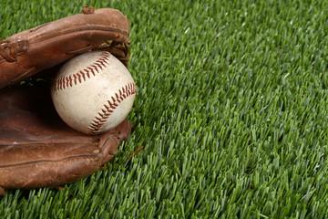 closeup baseball glove and ball