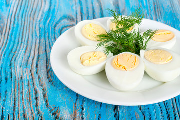 Boiled hen eggs and green dill