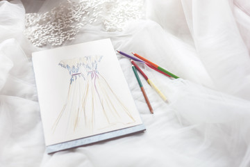 Drawing of bridal gowns in a designer shop