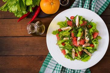 Fresh chicken salad, grapefruit, lettuce and honey mustard dressing. Dietary menu. Proper nutrition. Top view