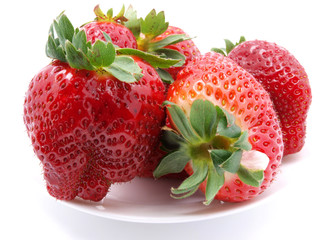 Red strawberries on white plate