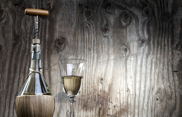 White wine and glass wooden background with copy space