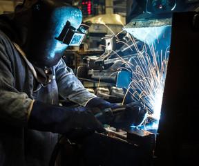 Industrial steel worker speeds motion in factory