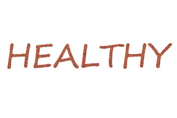 Wort HEALTHY buchstabiert aus Adzukibohnen als Freisteller auf weißen Hintergrund