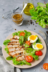 Chicken salad with leaf vegetables and cherry tomatoes