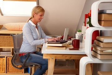 Happy woman working at home