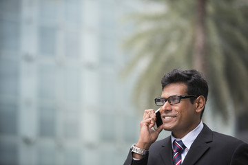 Indian business man talking on his Smart phone.