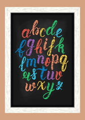 Chalk colorful hand drawn latin calligraphy brush script of lowercase letters on the blackboard. Calligraphic alphabet. Vector