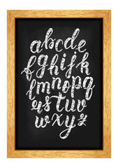 Chalk hand drawn latin calligraphy brush script of lowercase letters on the blackboard. Calligraphic alphabet. Vector