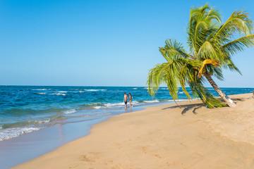 Couple at Punta Uva beach in Costa Rica, wild and beautiful caribbean coast