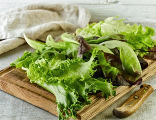 fresh lettuce on wooden cutting board