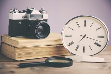 book, clock and camera