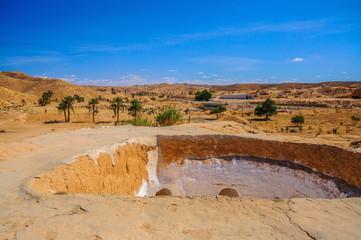 View of traditional berber bedouin house in Sahara desert in Tunisia