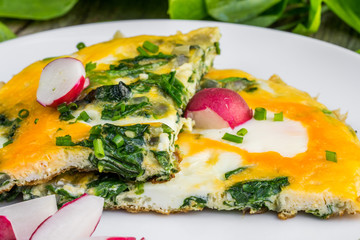 Spinach Omelette with Radish on a White Plate