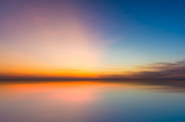 Colorful evening sunset with cloud in the sky reflect on sea. Tw