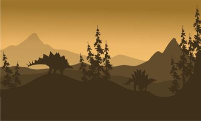 Landscape Stegosaurus silhouette in hills