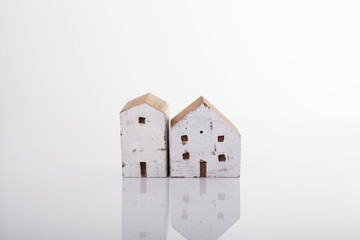 Miniature houses on white background.