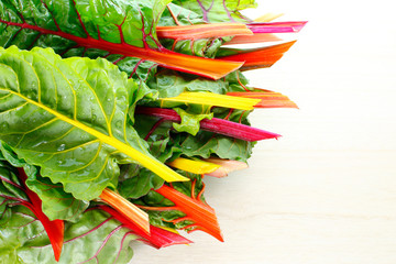 Colorful chard leaves in a bowl.