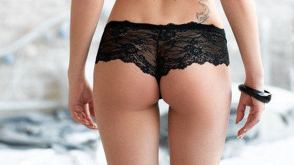 Closeup picture of woman buttocks in black lace panties . Extreme closeup of sexy woman ass. Perfect buttocks in black lace lingerie.