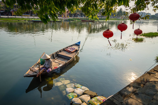 Vietnamese Woman on a wood boat