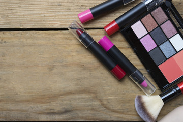 Set of colorful cosmetics on table background