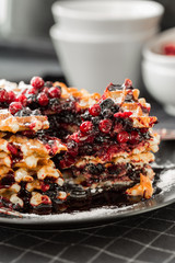 waffles with blueberry jam and cowberry