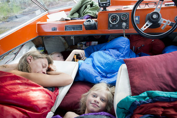 Family sleeping in a small boat