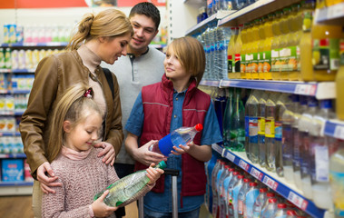 Family purchasing sparkling water in store.