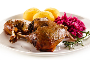 Roast duck legs and vegetables