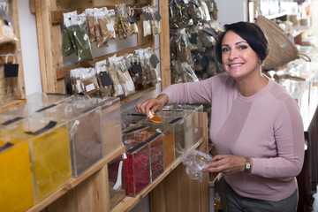 Female customer selecting dried spices