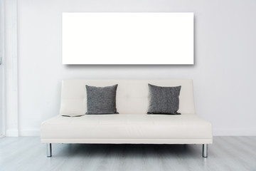 Mock up display white frame andTablet on white sofa bed in white