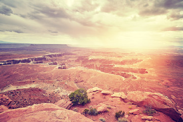 Vintage toned deserted landscape at sunset, Canyonlands National Park, Utah, USA.