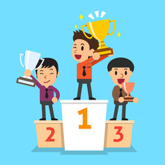 Businessmen winner standing on a podium and holding up winning trophies