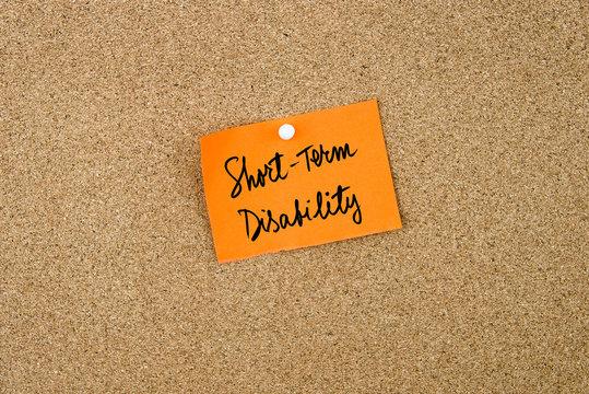Short Term Disability written on orange paper note
