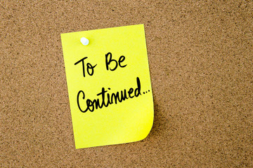 To Be Continued written on yellow paper note