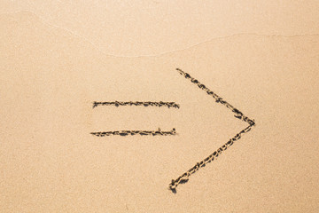 Drawn arrow on the sand