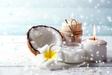 Spa coconut products on light wooden background with snow effect
