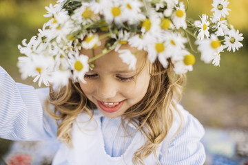 Smiling girl with flower wreath