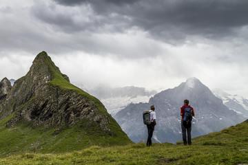Men looking at mountains