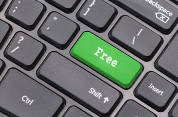 "Computer keyboard closeup with ""Free"" text on green enter key"