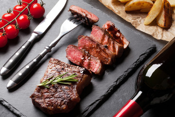 Grilled striploin steak and red wine